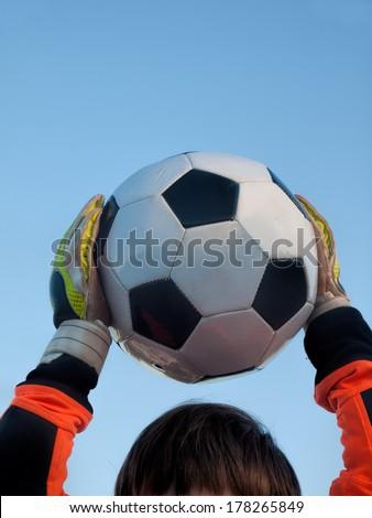 goalkeeper catches football / soccer-ball - stock photo