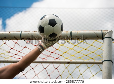 Goalkeeper catches the ball - stock photo