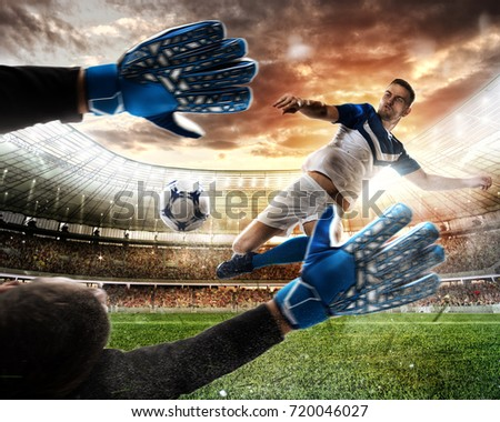 Goalkeeper catches the ball in the stadium