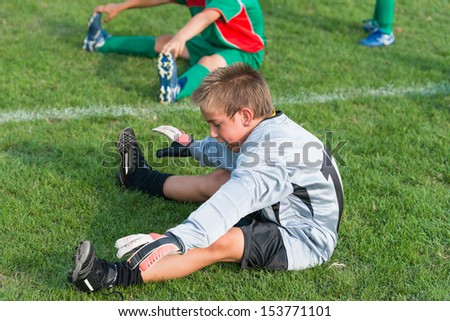 goalkeeper do stretch before football match - stock photo