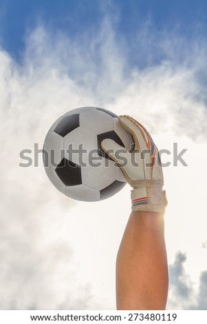 Goalkeeper getting the ball. - stock photo