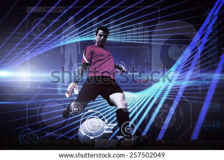 Goalkeeper kicking ball against black background with blue grid