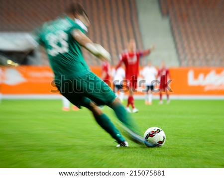 Goalkeeper kicking the ball. - stock photo