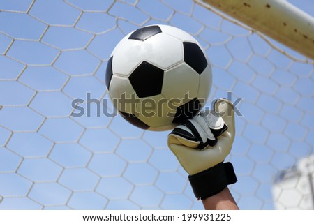 goalkeeper's hands punching a football. - stock photo