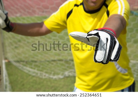 Goalkeeper use finger point for command another player soccer to protect goal. - stock photo