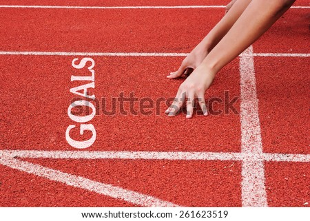 Goals - hands on starting line - stock photo