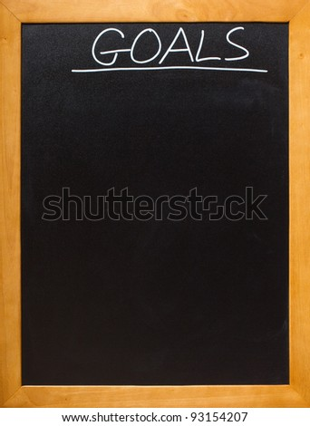 Goals in chalk on a blamk blackboard, lots of copyspace - add your own font - stock photo