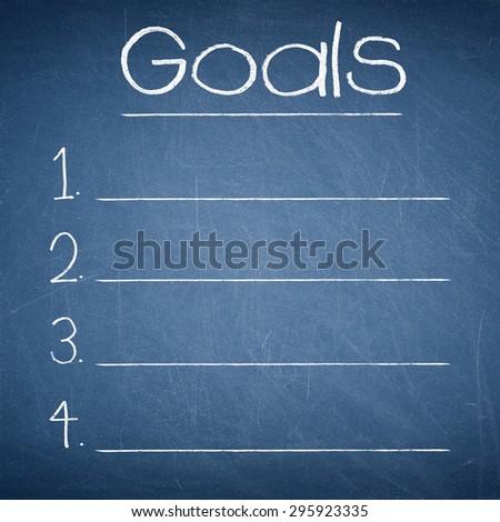 GOALS text written on a blue chalkboard - stock photo
