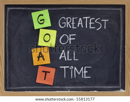 GOAT acronym (greatest of all time ) - sticky notes and white chalk handwriting on blackboard