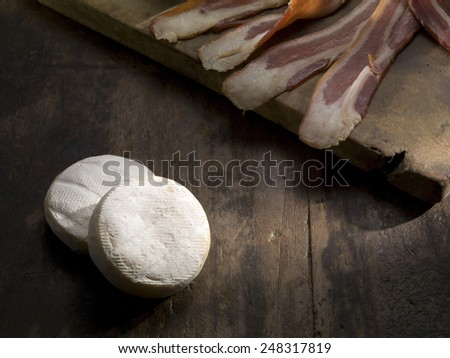goat cheese and bacon wood table background - stock photo