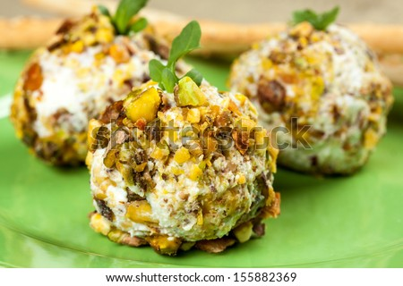 goat cheese balls with arugula and pistachio - stock photo