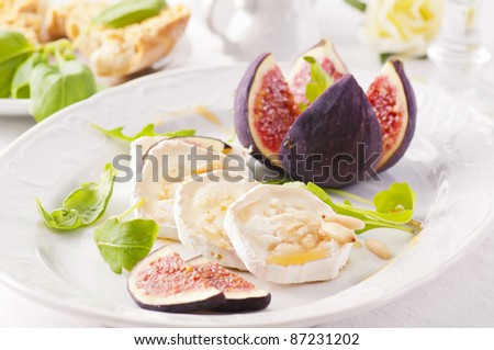 Goat cheese with fig and honey - stock photo
