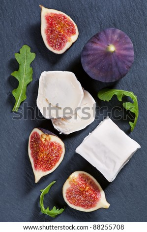 goat cheese with fig and rucola - stock photo