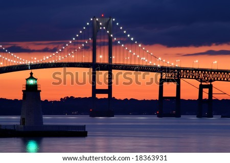 Goat Island Lighthouse at Sunset with Claiborne Pell Bridge in Background Horizontal - stock photo