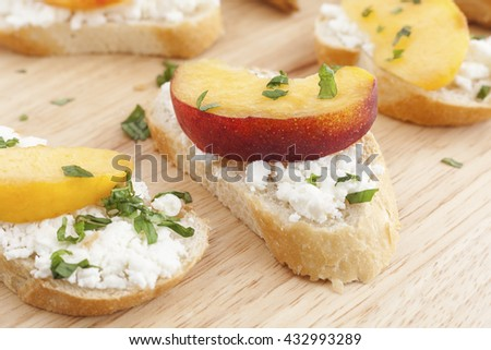 Goat's cheese and peach bruschetta healthy finger food. - stock photo