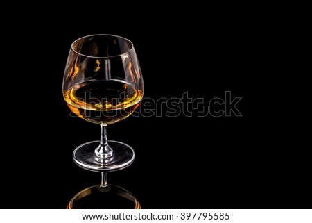 Goblet of Brandy on the black background - stock photo