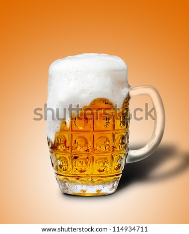 goblet of light beer foam. lager beer in a glass beaker with fresh bubbling foam. alcoholic fresh beverage  yellow color. pub drink. yellow background - stock photo