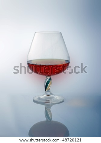 goblet with brandy, reflexion