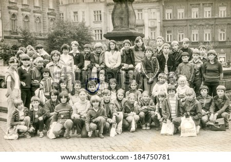 GOCZALKOWICE, POLAND, AUGUST 8, 1981: Vintage photo of group of classmates and teachers posing together during a school excursion - stock photo