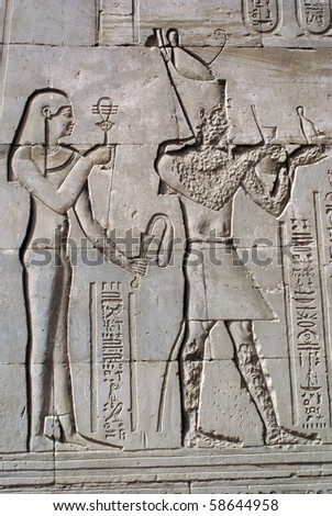 God and pharaon on the wall of Edfu temple, Egypt - stock photo