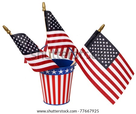 God Bless America! Red, white, and blue sand pail with three American flags, isolated on white. - stock photo