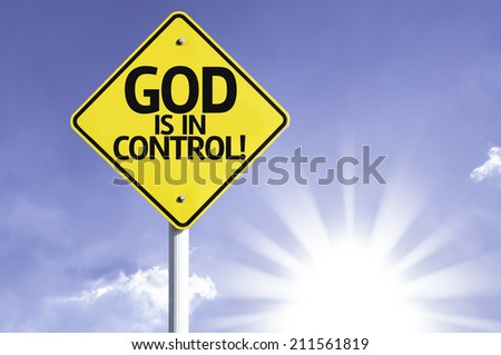 God is in Control road sign with sun background  - stock photo