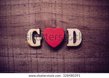 God is love concept text lying on the rustic wooden background. - stock photo