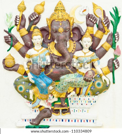 God of success 12 of 32 posture. Indian style or Hindu God Ganesha avatar image in stucco low relief technique with vivid color,Wat Samarn, Chachoengsao,Thailand. - stock photo