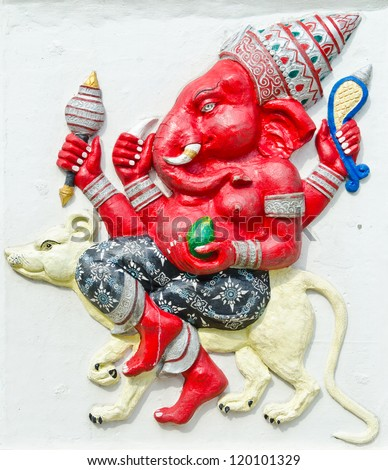 God of success 24 of 32 posture. Indian style or Hindu God Ganesha avatar image in stucco low relief technique with vivid color,Wat Samarn, Chachoengsao,Thailand. - stock photo
