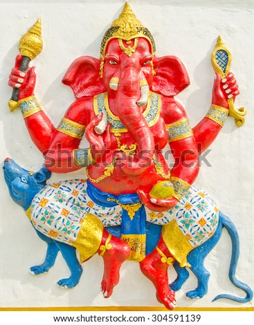 God of success 13 of 32 posture. Indian style or Hindu God Ganesha avatar image in stucco low relief technique with vivid color,Wat Samarn, Chachoengsao,Thailand. - stock photo
