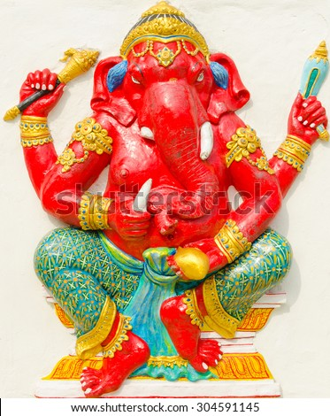 God of success 26 of 32 posture. Indian style or Hindu God Ganesha avatar image in stucco low relief technique with vivid color,Wat Samarn, Chachoengsao,Thailand. - stock photo
