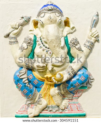 God of success 22 of 32 posture. Indian style or Hindu God Ganesha avatar image in stucco low relief technique with vivid color,Wat Samarn, Chachoengsao,Thailand. - stock photo