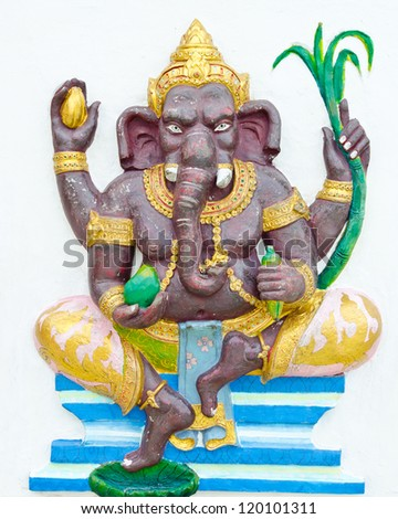 God of success 1 of 32 posture. Indian style or Hindu God Ganesha avatar image in stucco low relief technique with vivid color,Wat Samarn, Chachoengsao,Thailand. - stock photo