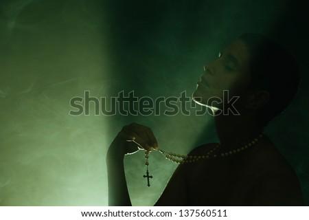 God's Energy - Woman Praying - stock photo