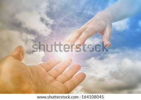 God's Saving Hand - stock photo