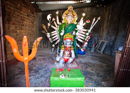 Goddess statue with many hands in the small temple in Maharashtra, India - stock photo
