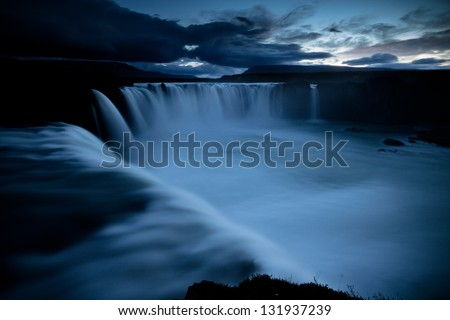 godfoss waterfall in iceland by night - stock photo