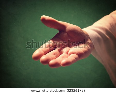 Gods hand reaching out, religion, salvation, forgiveness, assistance and love concept - stock photo