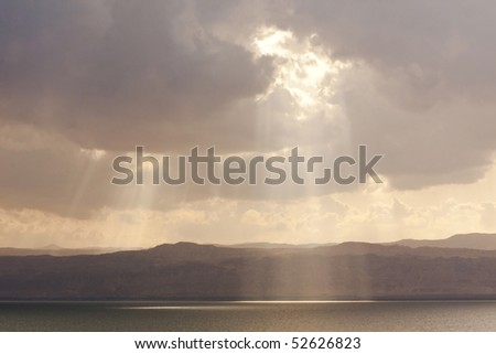 gods sunbeam above the jordan dead sea. Some Miles beyond the mountains is Jerusalem.