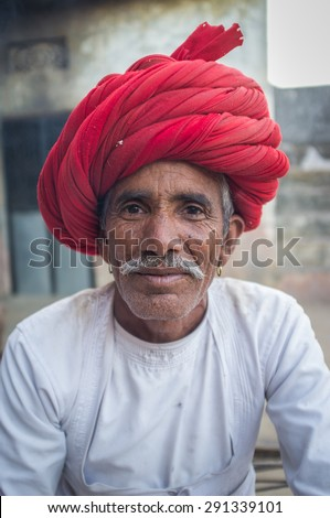 GODWAR REGION, INDIA - 12 FEBRUARY 2015: Rabari tribesman with traditional turban and clothes. Rabari or Rewari are an Indian community in the state of Gujarat. - stock photo