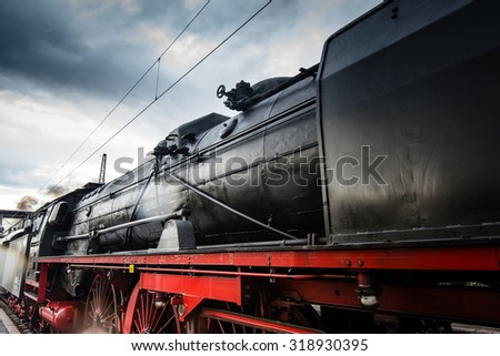 GOEPPINGEN, GERMANY - SEPTEMBER 19, 2015: Old steam locomotive in the station of Goeppingen, Germany during the Maerklin Days 2015: Maerklin, the largest German producer of model railroads - stock photo