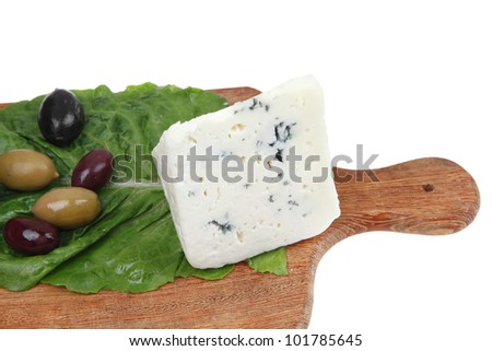 gogonzola mold cheese on wooden platter with olives and tomato isolated over white background