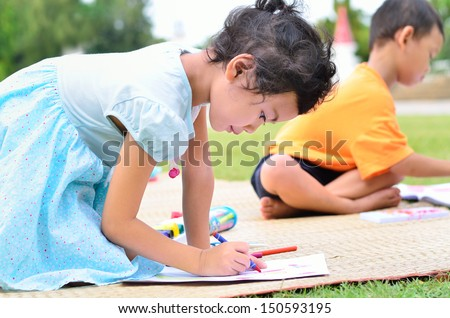 Going back to school : Children drawing and painting over green grass background / Asian kid students / group - stock photo