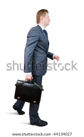 going businessman holding brief case over wite - stock photo