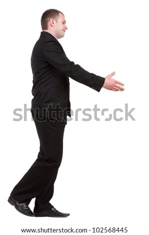 going businessman  in black suit  handshake.   Isolated over white background.