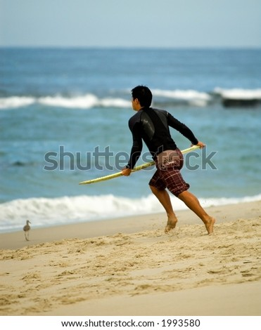 Going for the surf - stock photo