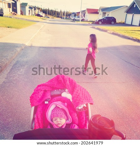 Going for walk in city with kids - Baby in Stroller - instagram effect  - stock photo