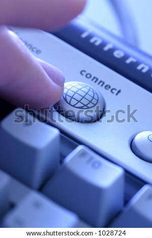 Going On-line: fingers press the button on a computer keyboard to go on-line; instant access to the internet. Shallow DoF leads eye to the action.