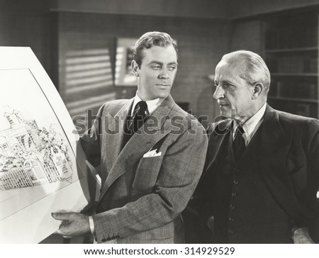 Going over design plan - stock photo