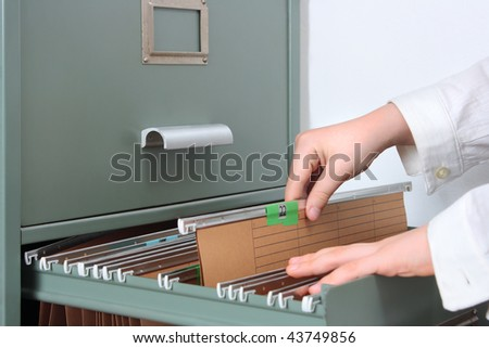going through the files, closeup - stock photo
